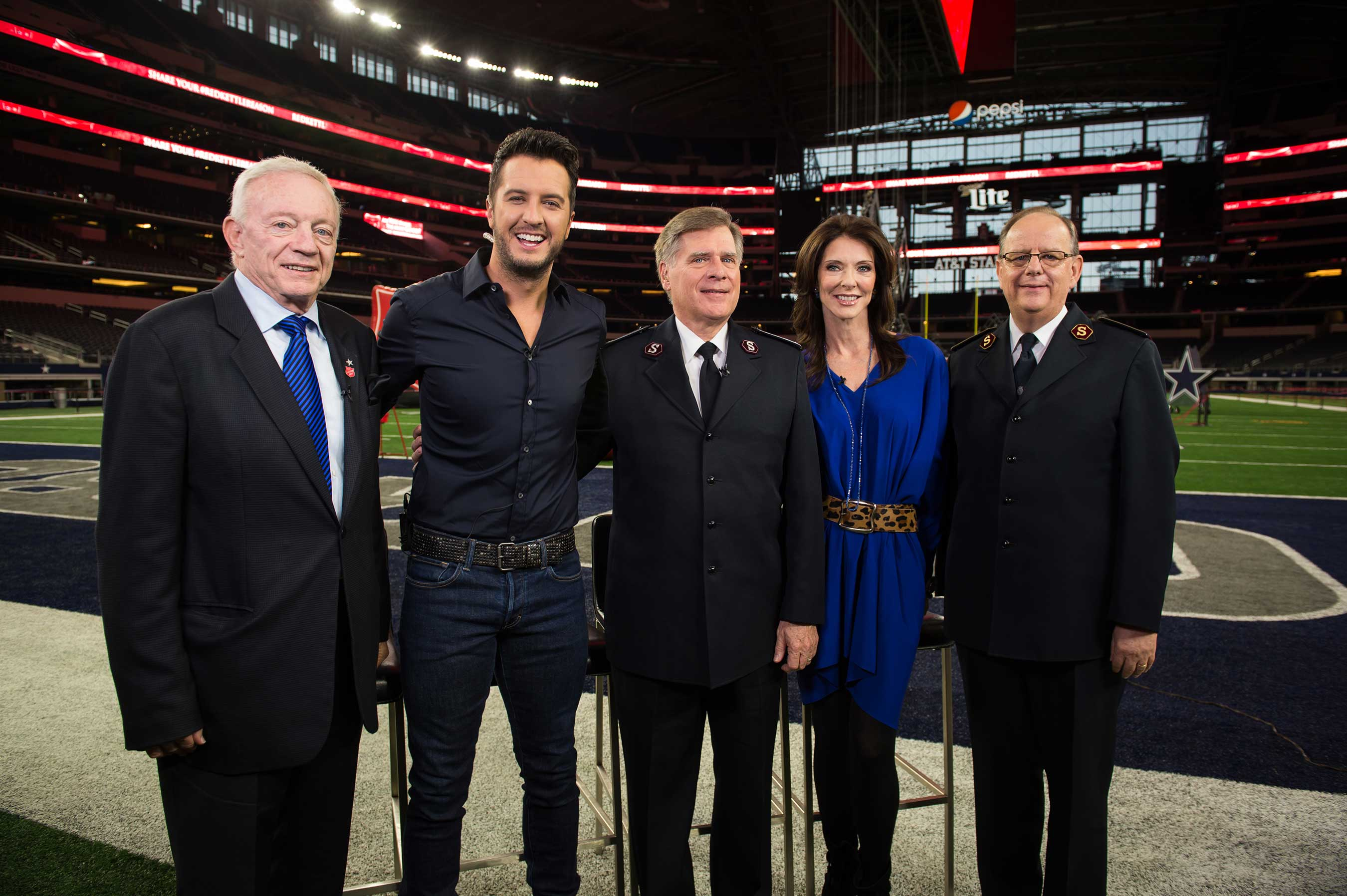 Jerry Jones, Luke Bryan, Commissioner David Jeffrey, Charlotte Jones Anderson and General André Cox at AT&T Stadium to celebrate the launch of the 125th Red Kettle Campaign.