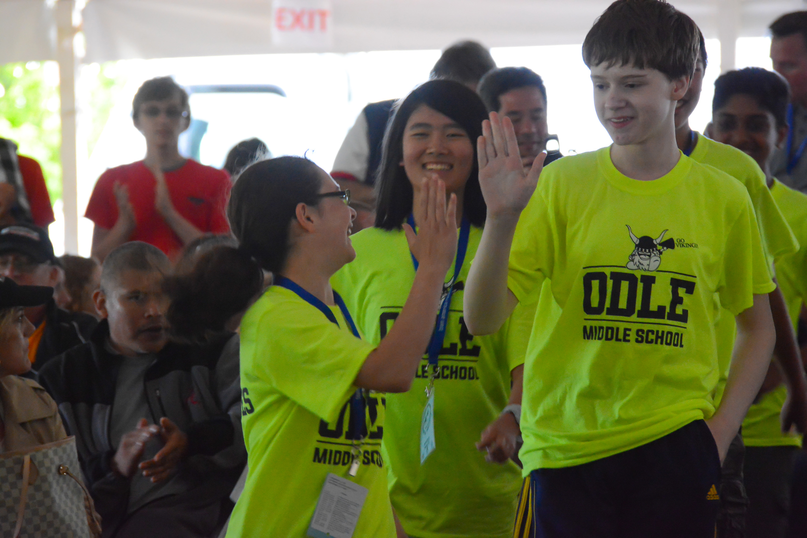 "The ""Space Potatoes"" rocketry team from Odle Middle School in Bellevue, Washington, shares a round of high fives after being named National Champions in the world's largest rocket contest."