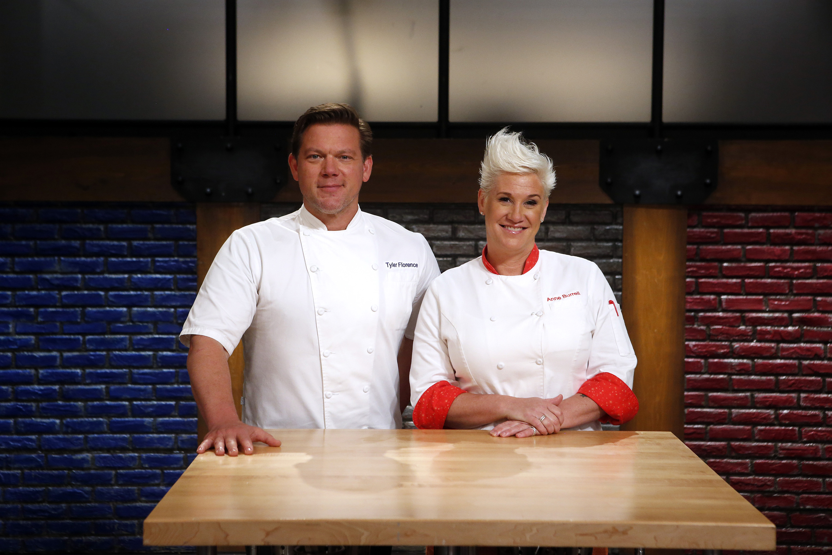 Hosts Tyler Florence and Anne Burrell of Food Network's Worst Cooks in America