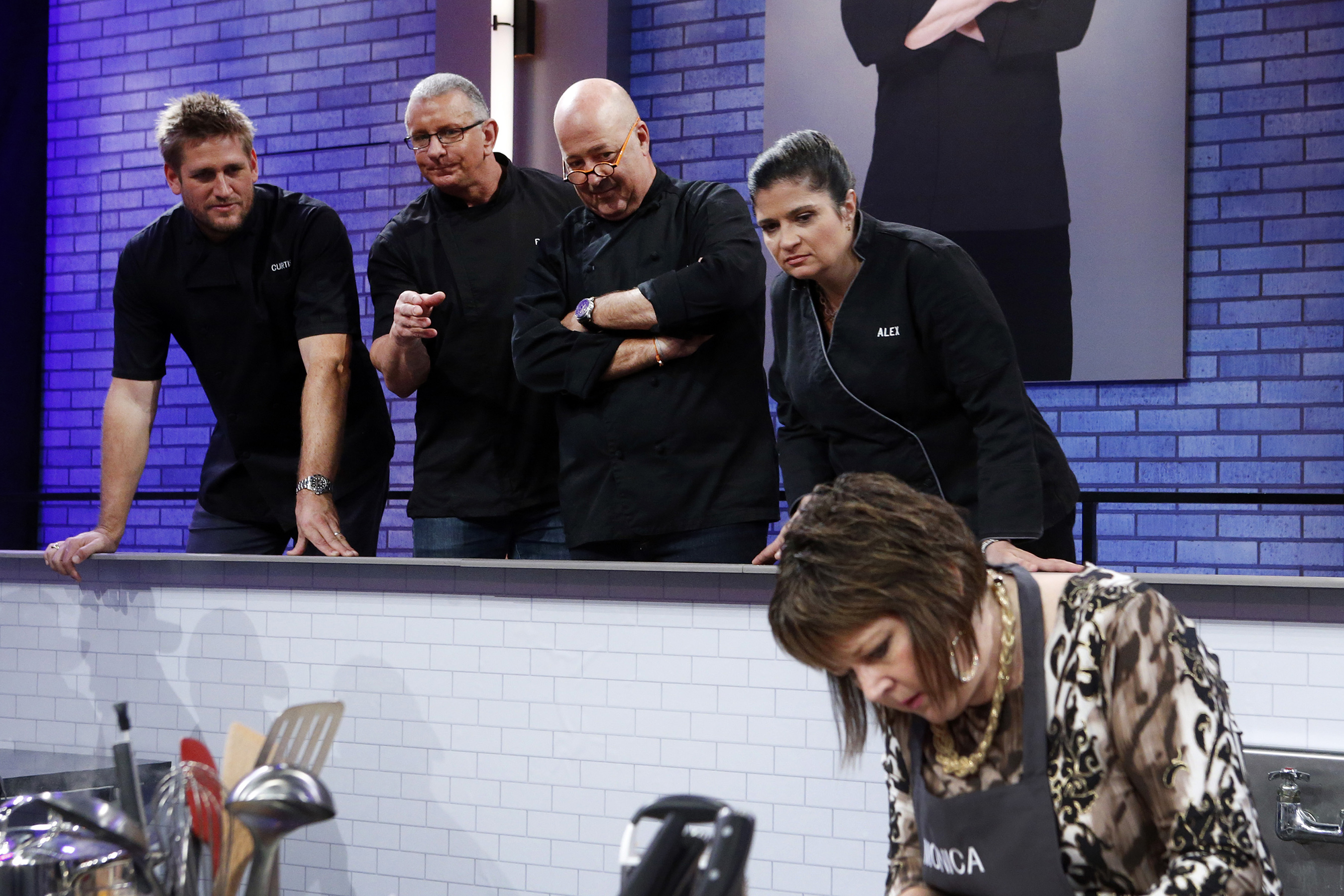 Mentors Curtis Stone, Robert Irvine, Andrew Zimmern and Alex Guarnaschelli observe contestant Monica Folken on Food Network's All-Star Academy