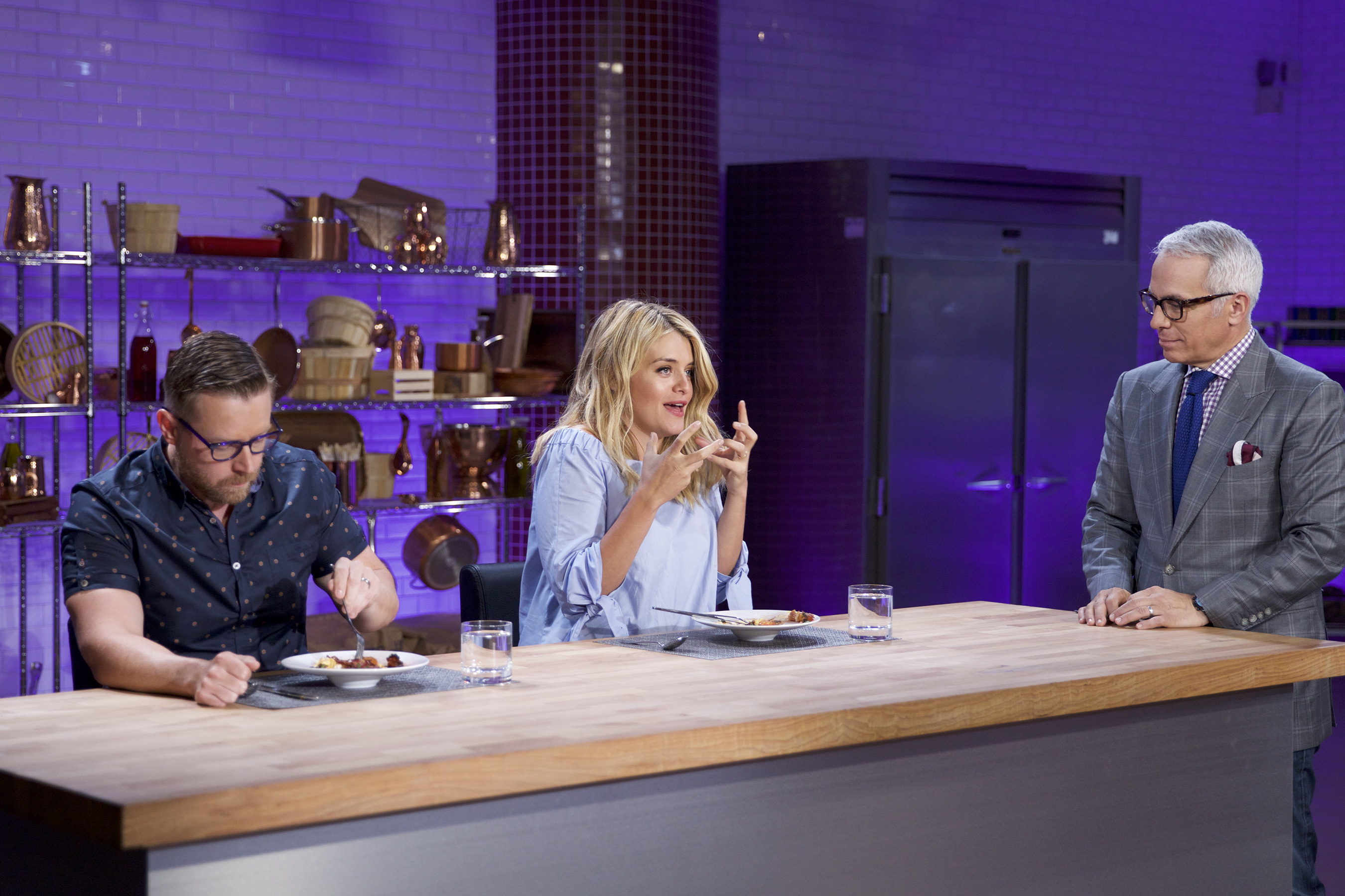 Judges Richard Blais and Daphne Oz with Host Geoffrey Zakarian on Food Network's Cooks vs. Cons