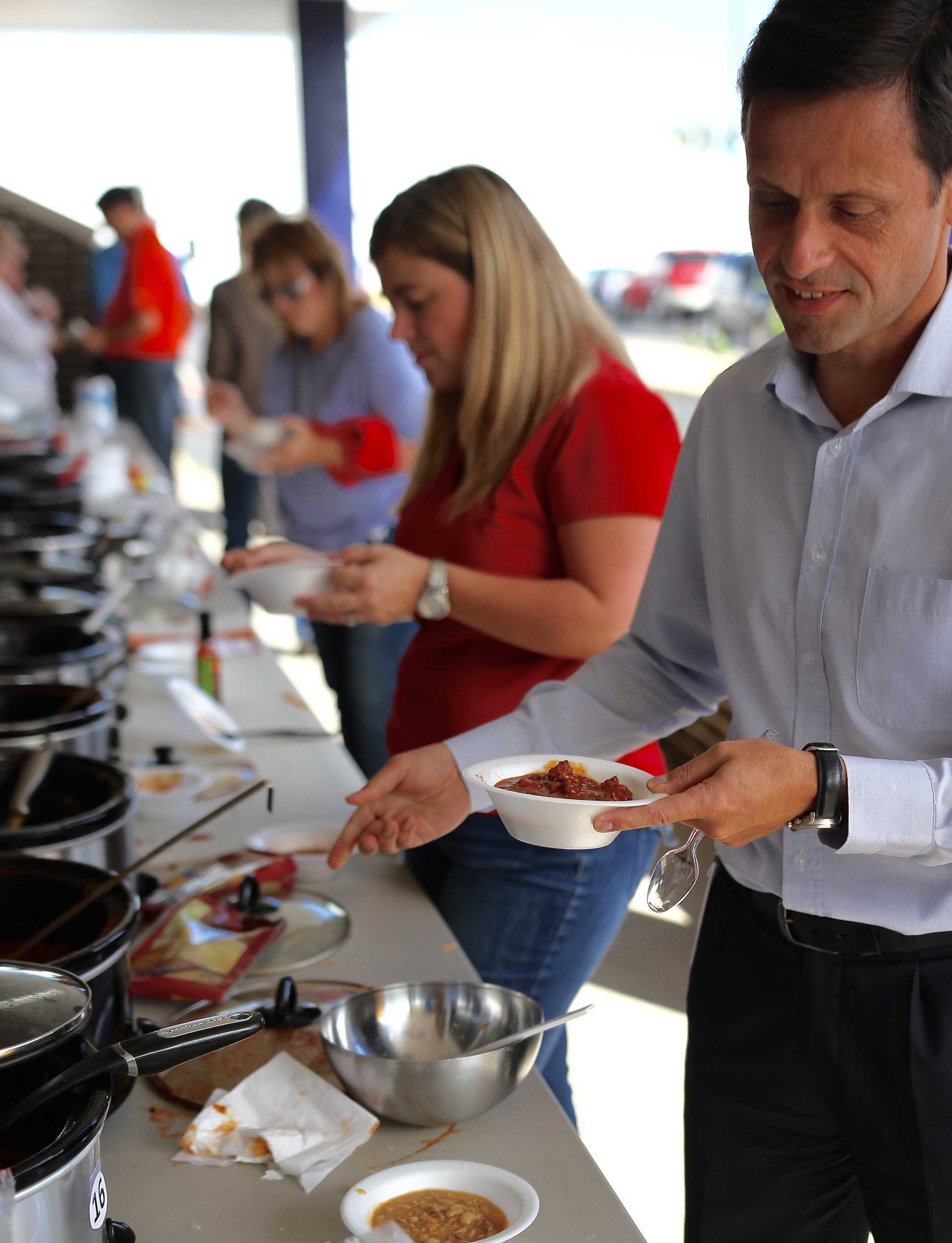 A big hit in Columbus, Indiana, Faurecia employees participate in an annual chili cook-off to raise money and donations for FUELS local food bank partner, the Love Chapel.