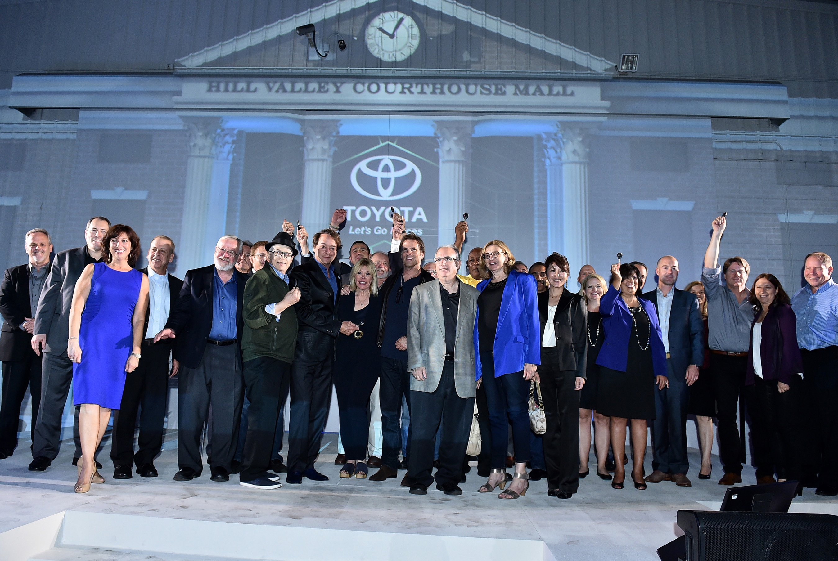 "Owners receive ceremonial keys to the Mirai hydrogen fuel cell car at Toyota's ""Back to the Future"" themed event on Tuesday, Oct. 20, 2015, in West Hollywood, Calif. (Photo by Jordan Strauss/Invision for Toyota/AP Images)"