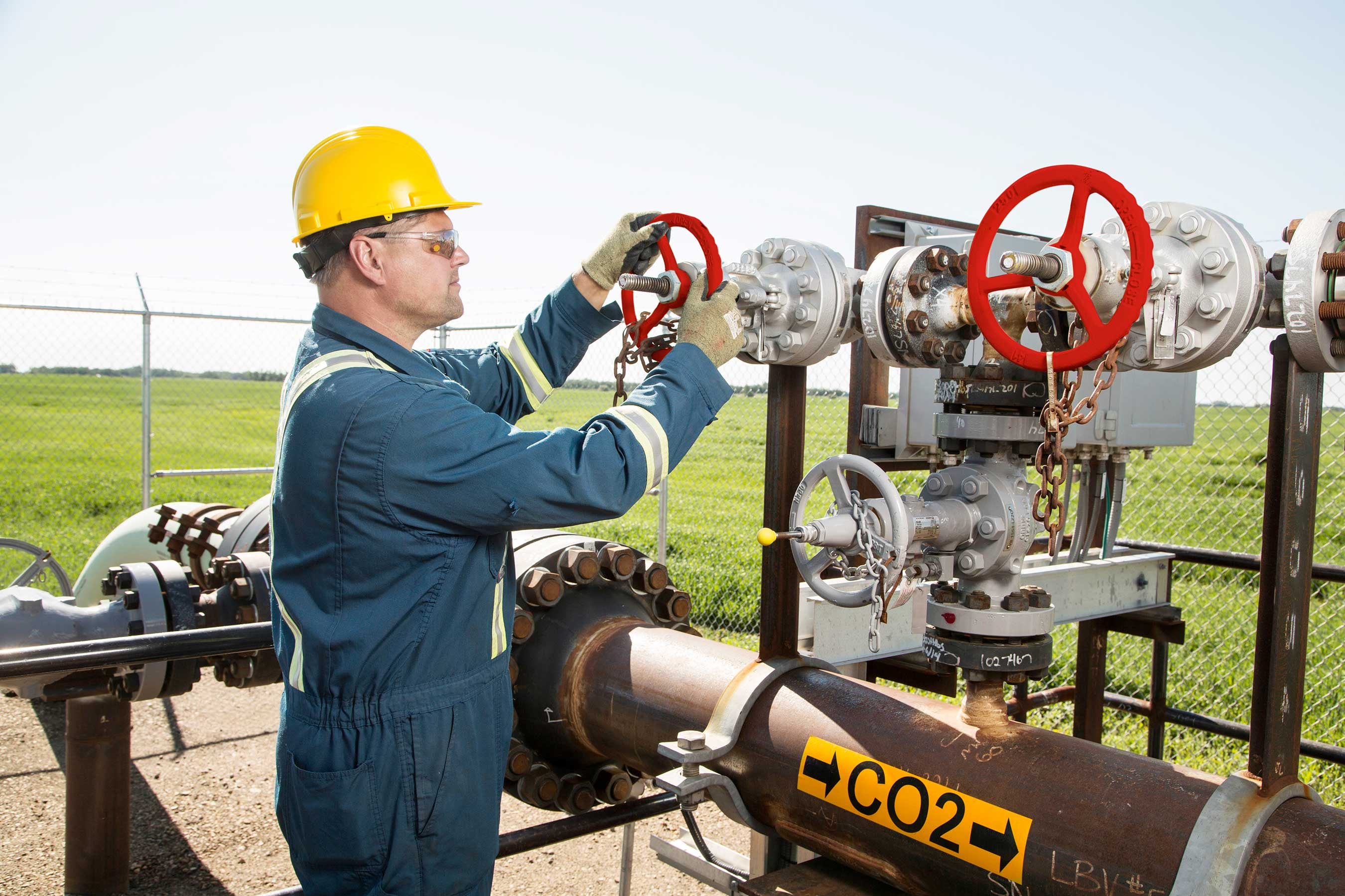 A pipeline operator works on a valve, which is part of the Quest CO2 pipeline