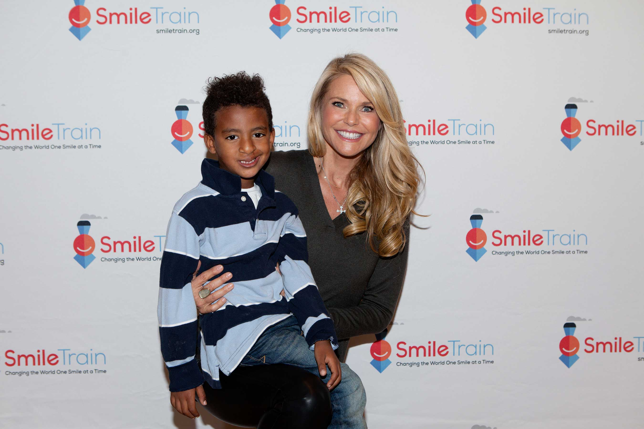 Christie Brinkley shows off her best smile with 5-year-old Zachary, a Smile Train cleft patient.