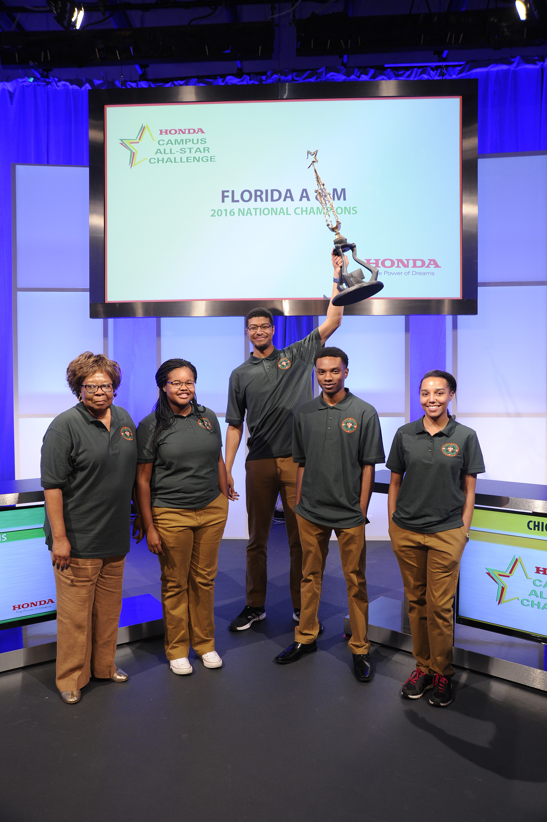 The team from Florida A&M University celebrates their win of the 27th Honda Campus All-Star Challenge National Championship with their coach, Dr. Vivian Hobbs (left).