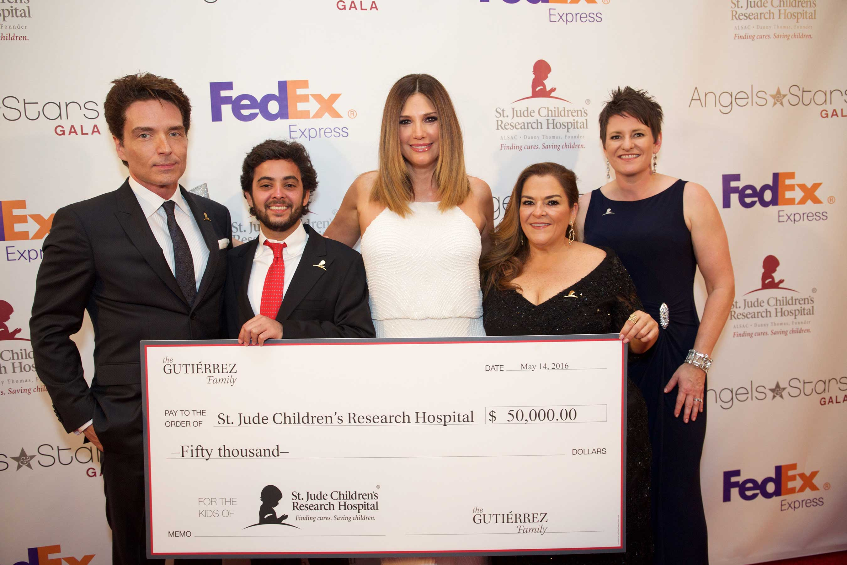 Richard Marx, St. Jude patient Stephan, Gala honoree Patty Gutierrez, ALSAC/St. Jude Children's Research Hospital's Chief Marketing Officer Emily Callahan