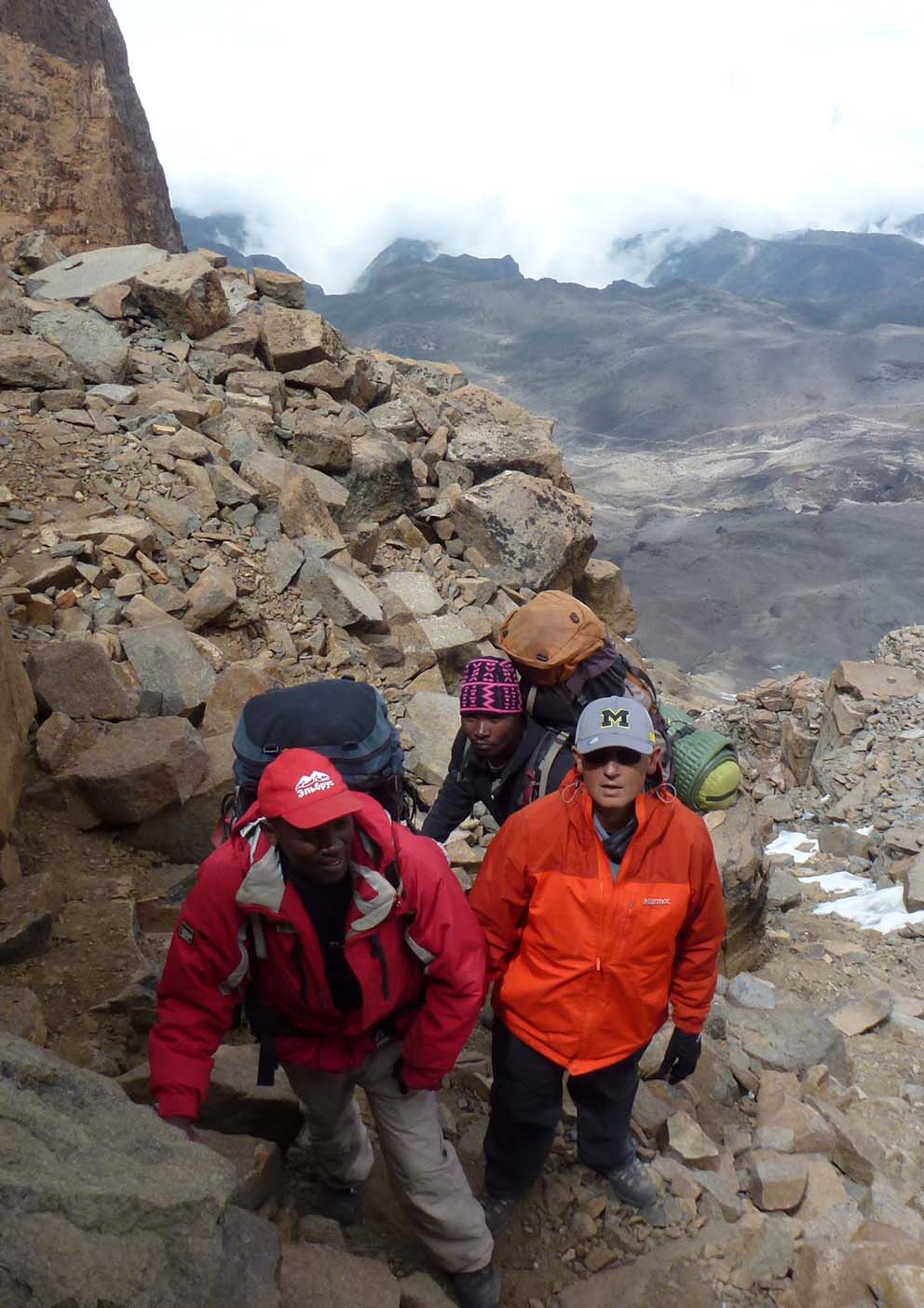John Loussia climbing Mt. Kilimanjaro