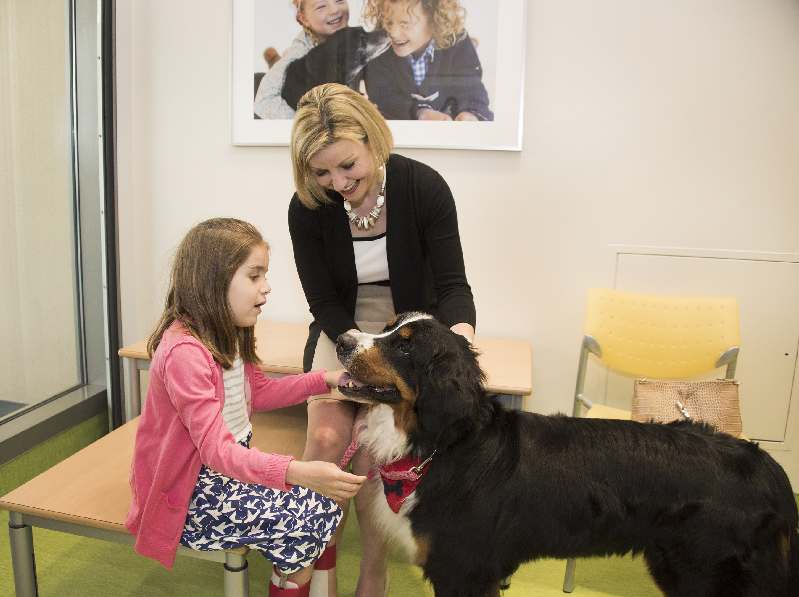 Purina veterinarian Dr. Zara Boland and her dog Rhumba visiting Annie, a St. Louis Children's Hospital patient, in the newly opened Purina Family Pet Center.