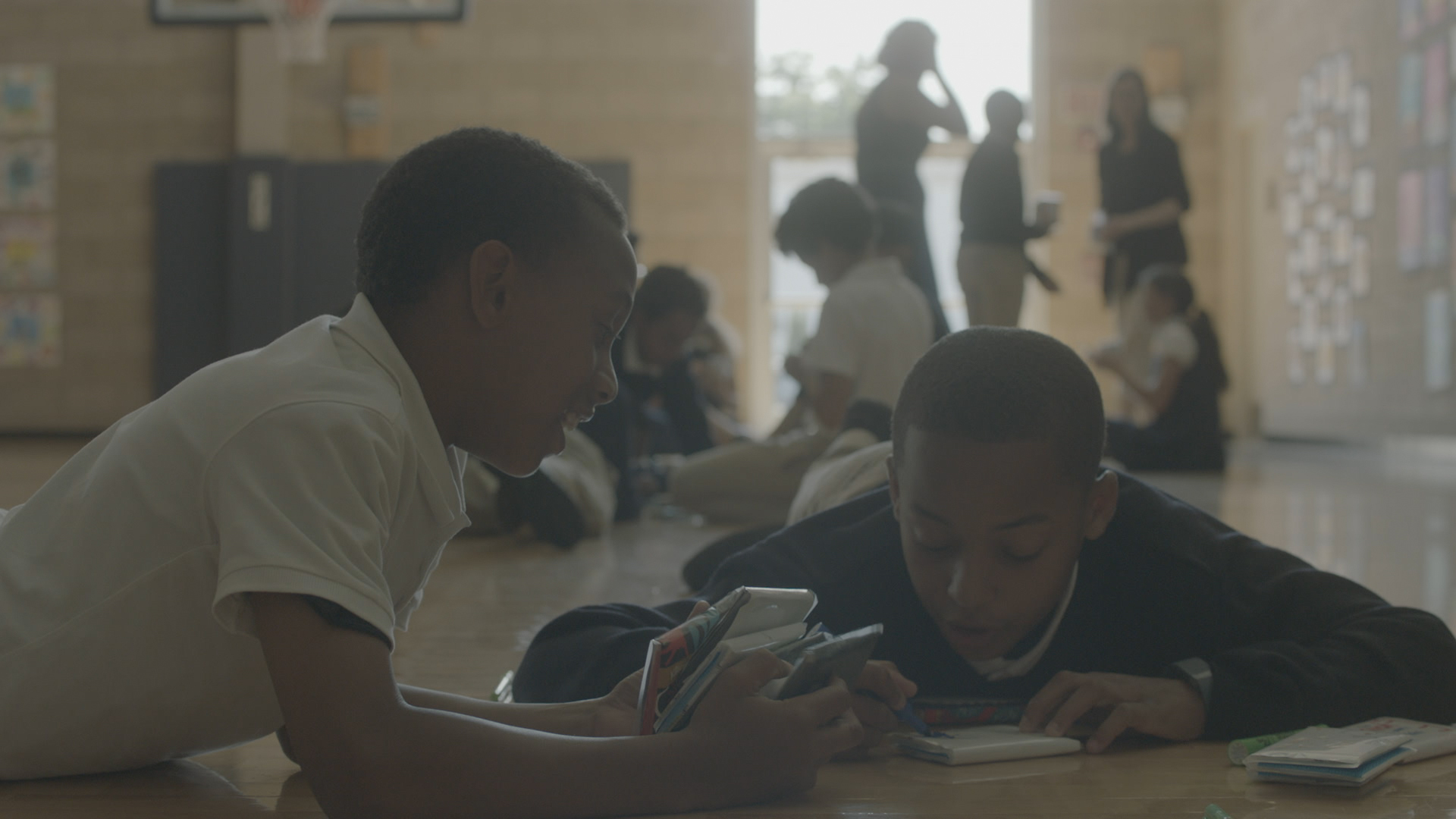 Male participants utilize Kleenex® Care kits to share care with their peers. Photo Credit: Kleenex® brand.