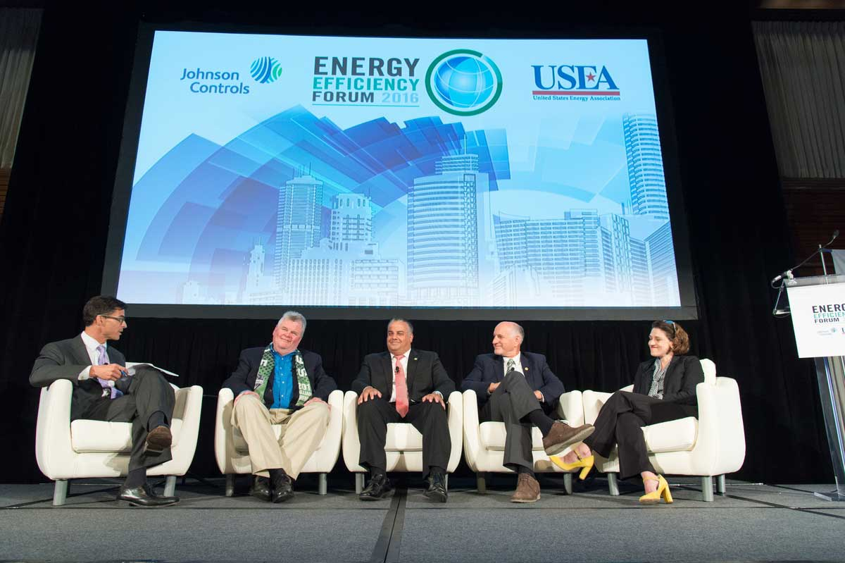 During a panel discussion, mayors talk about LED lighting, hydro-electric power, and electric bikes.