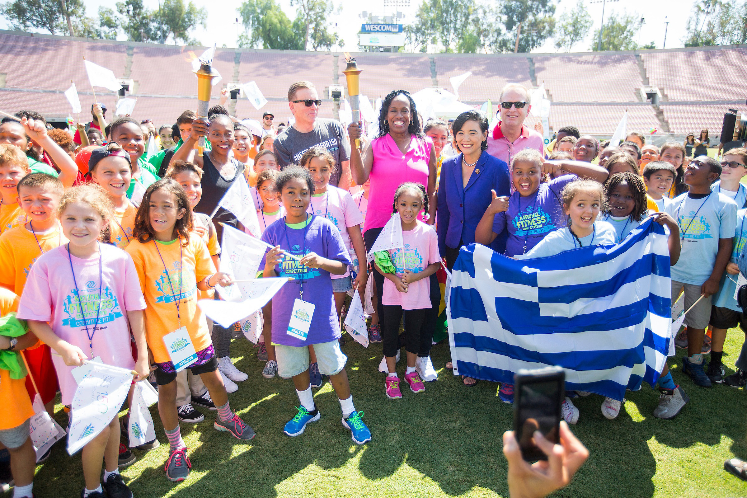 "Track and Field Olympic Champions Gail Devers and Jackie-Joyner Kersee ignite the ""Gold Medal Games"" National Fitness Competition in a traditional fashion carrying Olympic inspired torch"