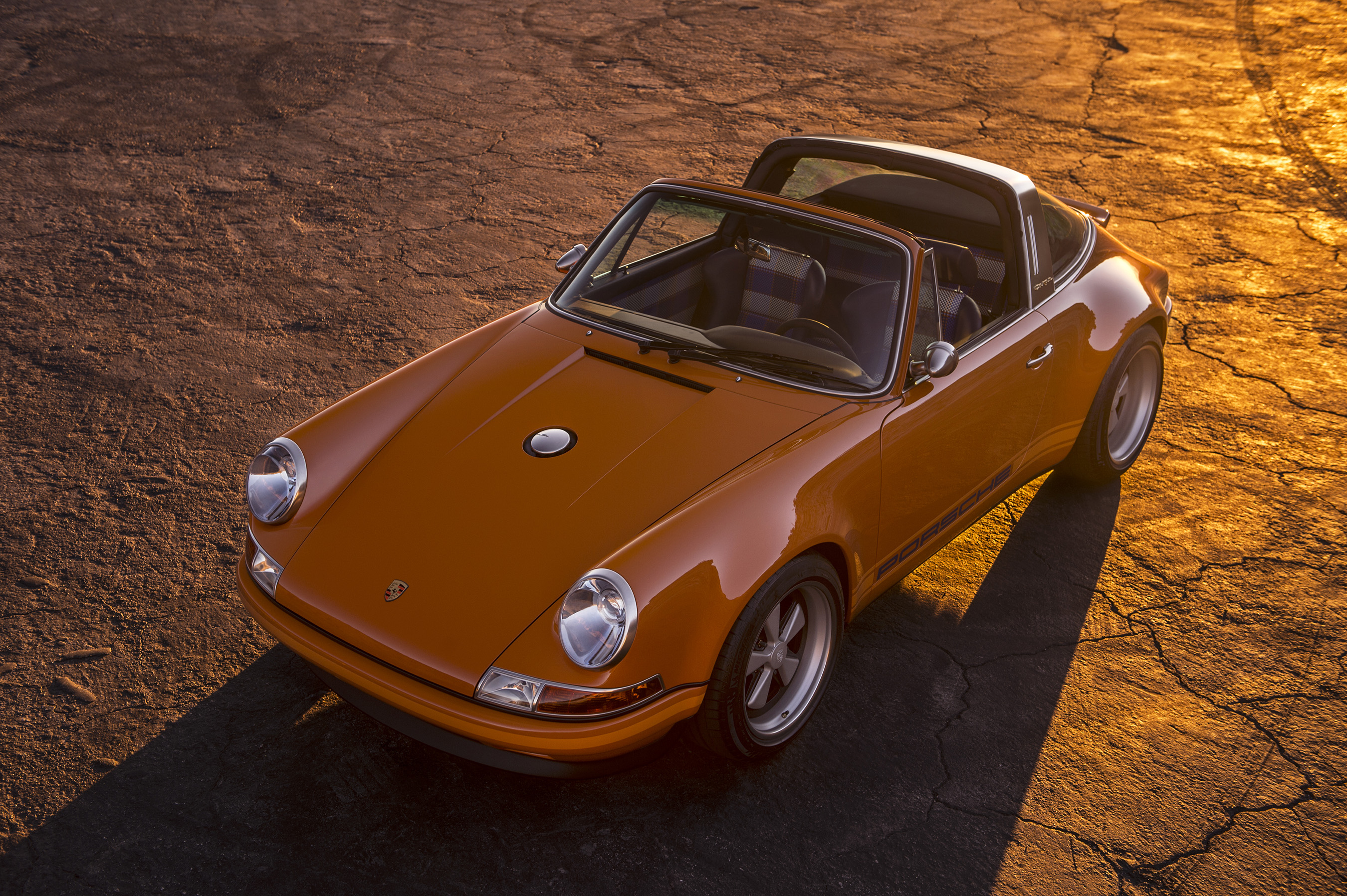 Beautifully bespoke, the 964 4.0-liter 'Luxemburg' Targa boasts a Deep Orange exterior and Navy Blue leather 'Tyler Tartan' interior, and includes a matching Navy canvas carbon fiber removable roof.