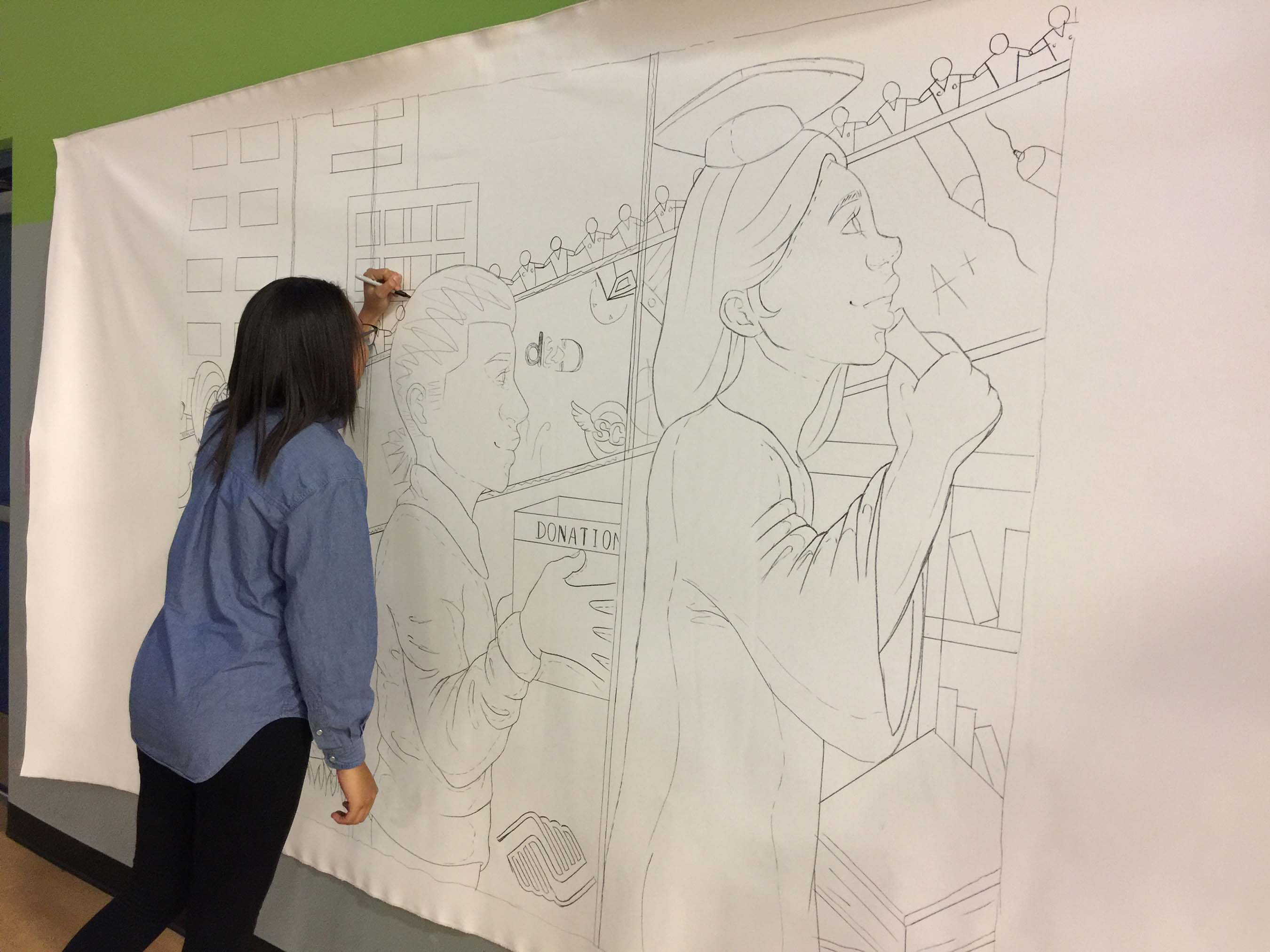 Club Member Debora C. sketches an original mural design for Renovation Across the Nation Clubs.