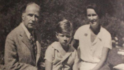 An old black and white photo of Robbie and parents 1935