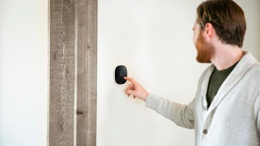Man adjusting temperature on the ecobee thermostat