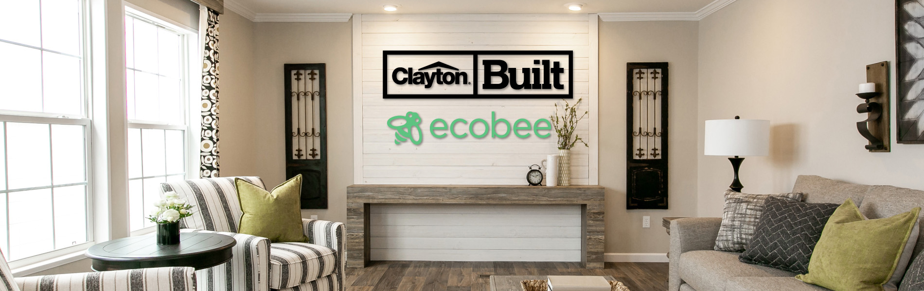 Clayton and ecobee signs on a wall in a living room