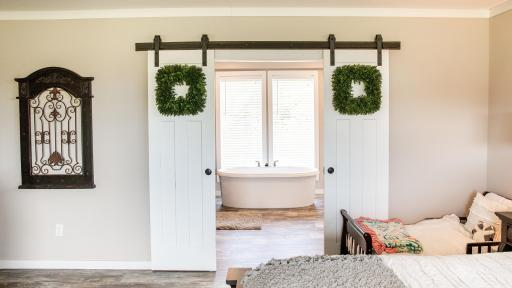 Sliding bathroom barn doors and free standing tubs.