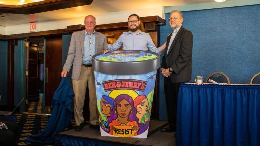 Ben & Jerry's Co-founders Ben Cohen (left) and Jerry Greenfield (right) join Ben & Jerry's CEO Matthew McCarthy (center) on stage unveiling a new flavor, Pecan Resist.