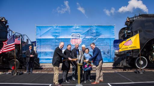 People tapping a ceremonial Golden Spike from left are Sandy Dodge, descendent of Gen. Grenville Dodge; Utah Gov. Gary Herbert, Union Pacific Chairman, President and CEO Lance Fritz, Utah Congressman Rob Bishop, Margarat Yee, a descendent of a Central Pacific employee, and Scott Moore, Union Pacific senior vice president-Corporate Relations and chief administrative officer.
