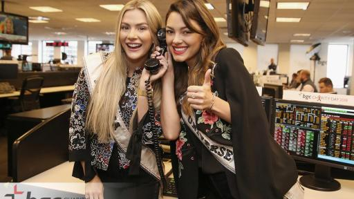 Miss USA and Miss Universe answer phones for BGC charity event.