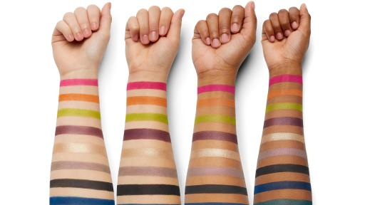 4 arms of various shades with the eye makeup colors in stripes on the arms.
