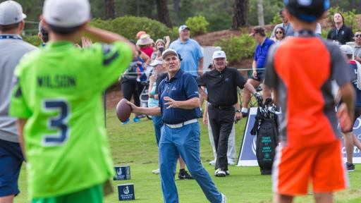Mark Rypien throwing a football on the golf course while spectators watch