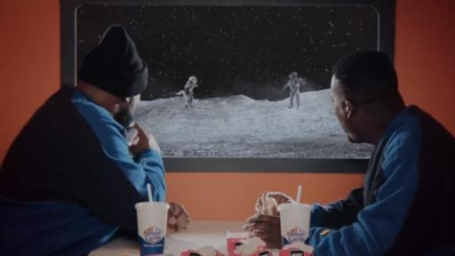 Wu-Tang eating Impossible™ Sliders looking out at a moonscape.