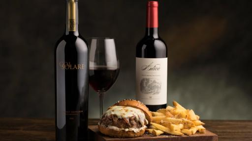 Caramelized Onion Wagyu Burger with glass of wine