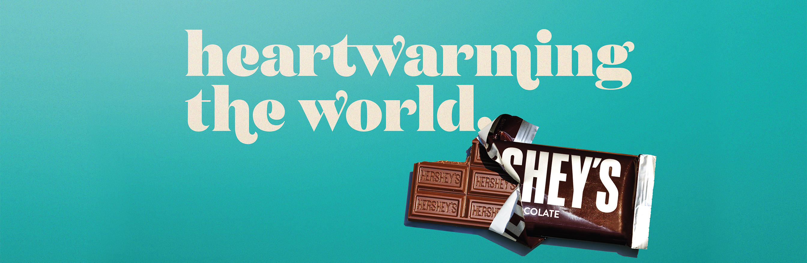 Open Hershey's bar with tagline: heartwearming the world