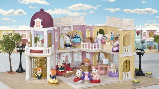 The toys Calico Critters in various rooms in a toy mall-like setting.