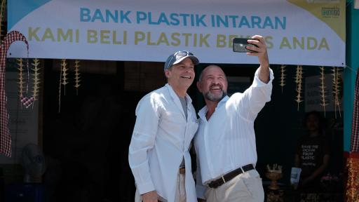 Fisk Johnson, Chairman and CEO of SC Johnson and David Katz, CEO of Plastic Bank, taking selfies in front of a sign.