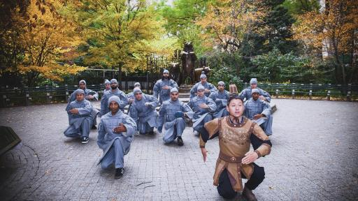 People dressed as terracotta warriors perform a pose of the Terracotta Army in Central Park