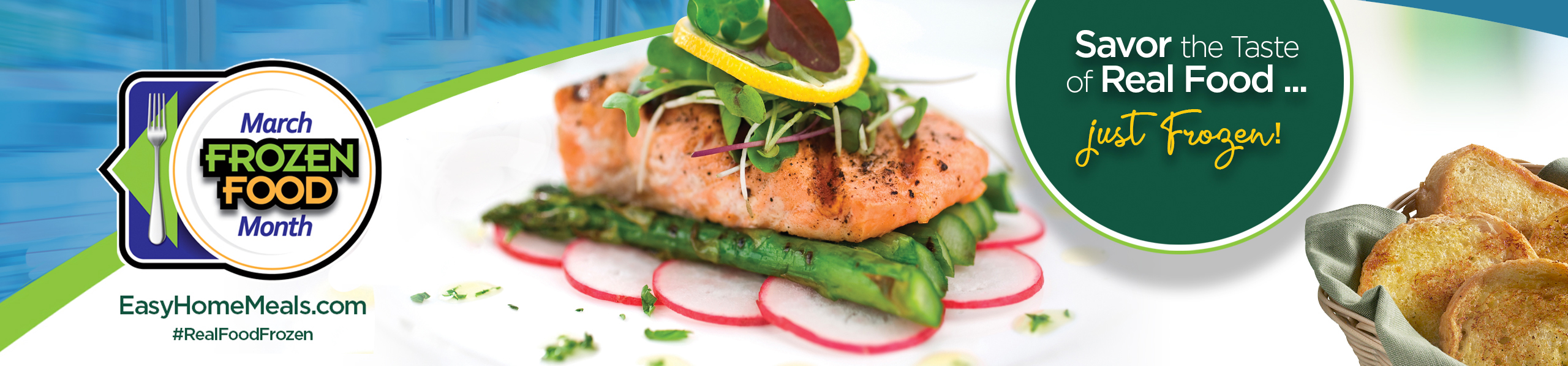 Salmon placed on asparagus, topped with various lettuce leaves.