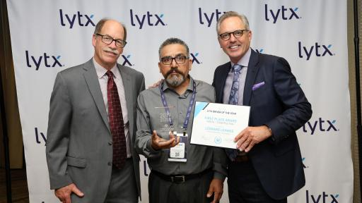 Leonard Leanos of Waste Management San Gabriel holding award for Lytx Driver of the Year