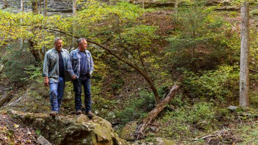 Designer Cottage homeowners, Jack and Harlen, explore the hiking trails of the Deer Lick Falls tiny community.