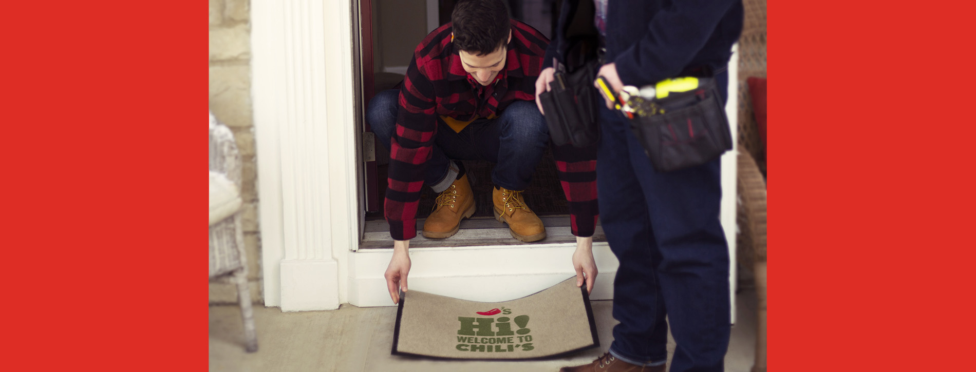 Man placing doormat in front of door.