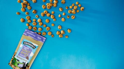 Cookie Dough Chunks spilling out of the package on a blue background
