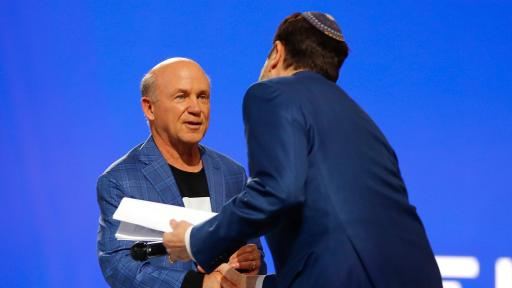 Chick-fil-A CEO Dan Cathy, honorary co-chair of the Beloved Benefit, welcomes Rabbi Peter Berg to the stage for the invocation during the event on Thursday, March 21, 2019 at Mercedes-Benz Stadium in Atlanta.
