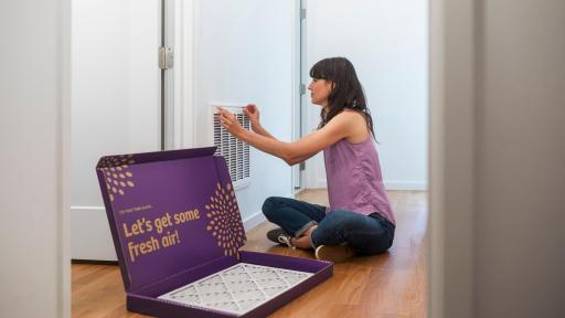 Woman installing air filters