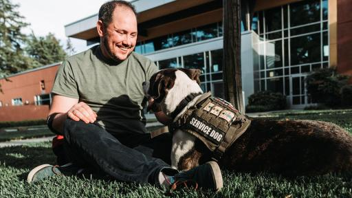 "Ethan, a Navy veteran with his service dog Finnegan. Ethan was a member of ARF's Pets and Vets graduating class in 2018. ARF has once again partnered with Purina Dog Chow for its second annual ""Service Dog Salute"" campaign to raise awareness on how military veterans suffering from PTSD and their families benefit from having a service dog."