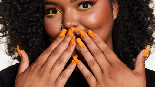 Woman with Cheetos Dusted Nails fingernails