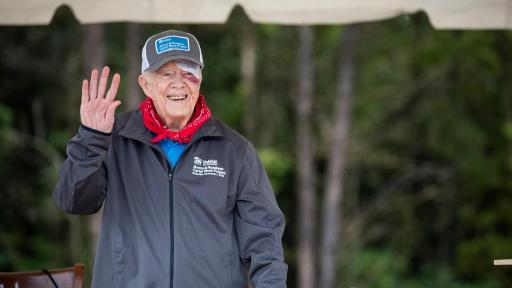 Jimmy Carter waves at viewer