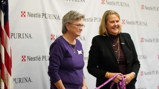 At the grand opening ceremony for Purina's Hartwell factory, Purina also announced a $20,000 donation to the Northeast Georgia Council on Domestic Violence (NGCDV) as part of its Purple Leash Project, a partnership between Purina and national non-profit RedRover. Pictured left is Katherine Reusing, Executive Director of Northeast Georgia Council on Domestic Violence, and pictured right is Purina President Nina Leigh Krueger.