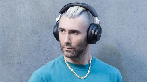 Adam Levine wearing Sure AONIC 50 Wireless Noise Cancelling Headphones