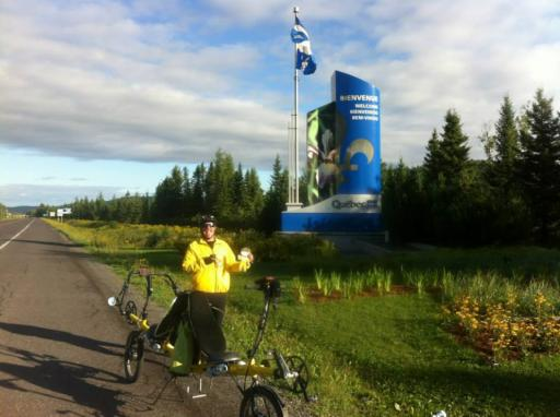 Bob and Flat Stanley at the Quebec-New Brunswick border.