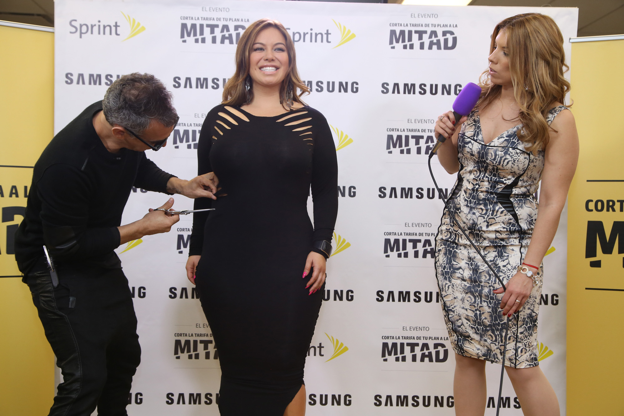In collaboration with Sprint and Samsung, Chiquis Rivera smiles during the transition of her dress for the Sprint Cut Your Bill in Half Event.