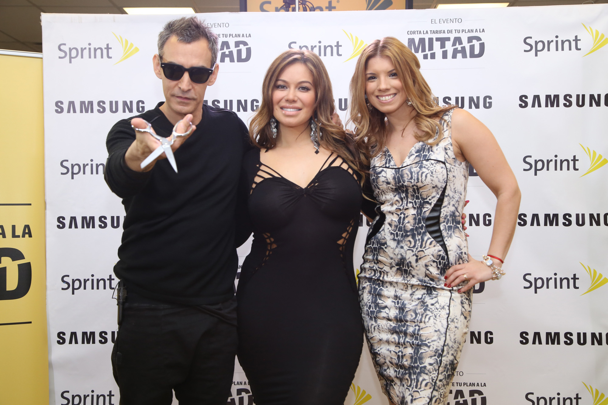 Designer Adam Saaks, Chiquis Rivera and Super Latina, Gabriela Natale pose during the culmination of the Sprint Cut Your Bill in Half Event with the final result, Chiquis cut dress.