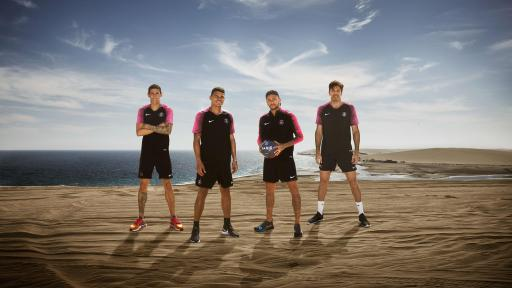 Image of four Paris Saint-Germain Football players in the Qatar Desert.