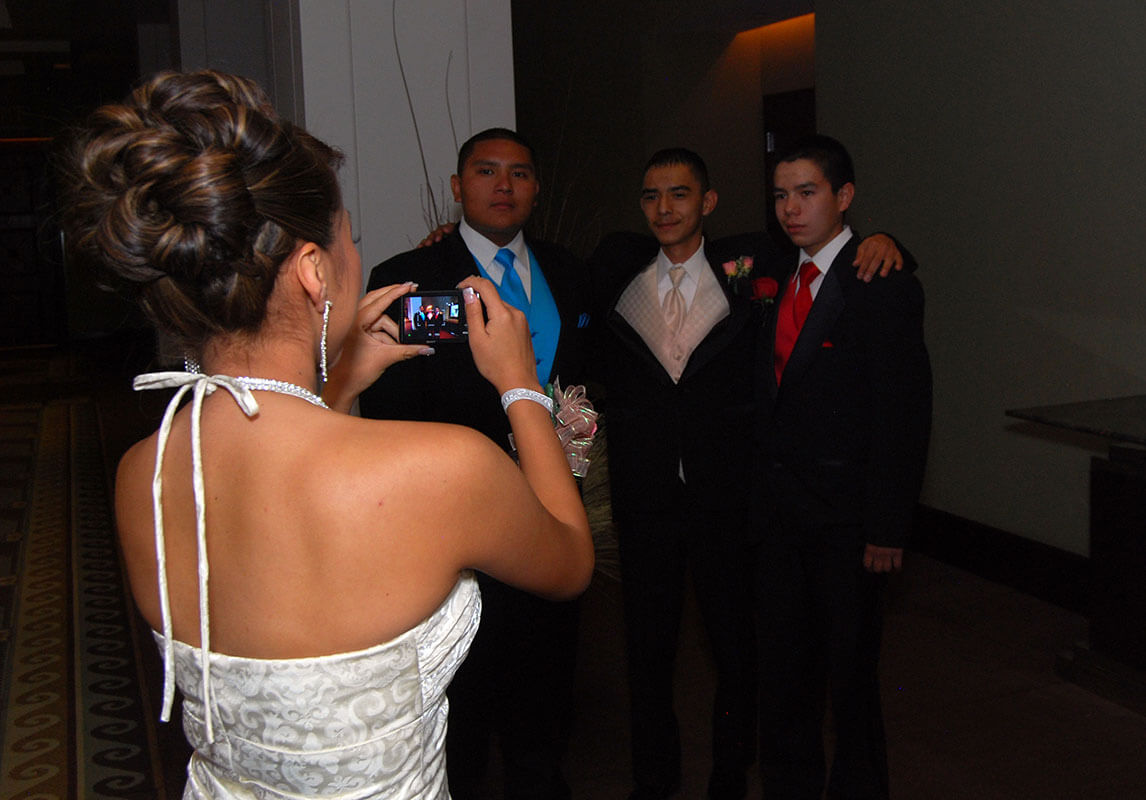 bride taking a photo of groomsmen
